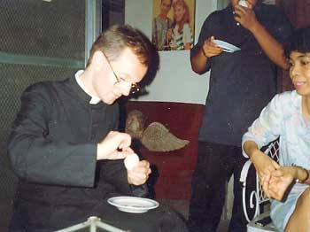 Fr. Abraham eating balut