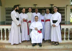 Bishop Fellay with priests in Asia